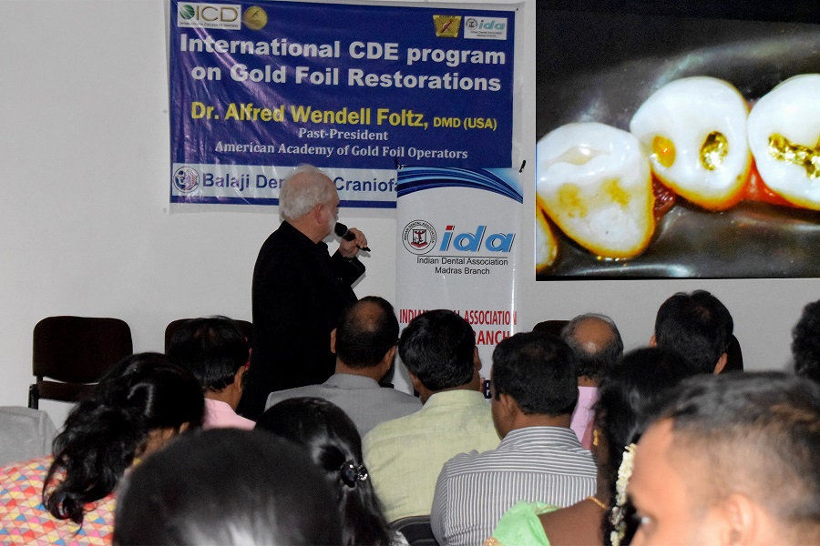 Prof Foltz delivering his keynote lecture on direct gold foil restorations at the CDE program