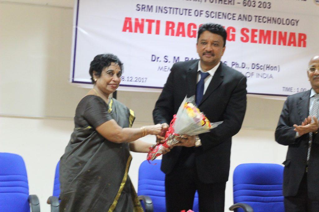 Dr Chandra Prabha warmly greeting Dr Balaji at the function