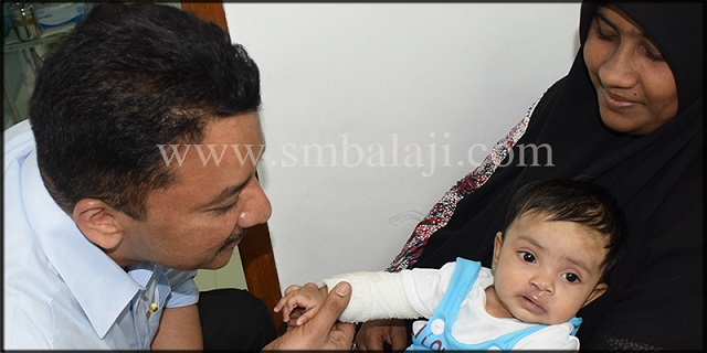 Dr S M Balaji with baby girl 15 days after surgery