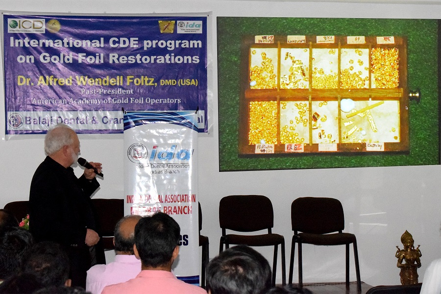 Prof Foltz delivering his keynote lecture on direct gold foil restorations at the CDE program