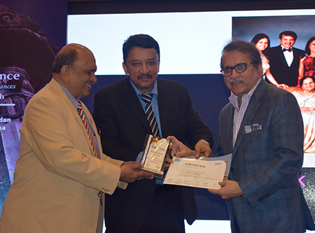 "Dr. Balaji and Dr. Meshram presenting Dr. Sandesh Mayekar with a Certificate of Appreciation at the end of Dr. Mayekar's keynote speech ""Functional Smile Designing"" at the conference"