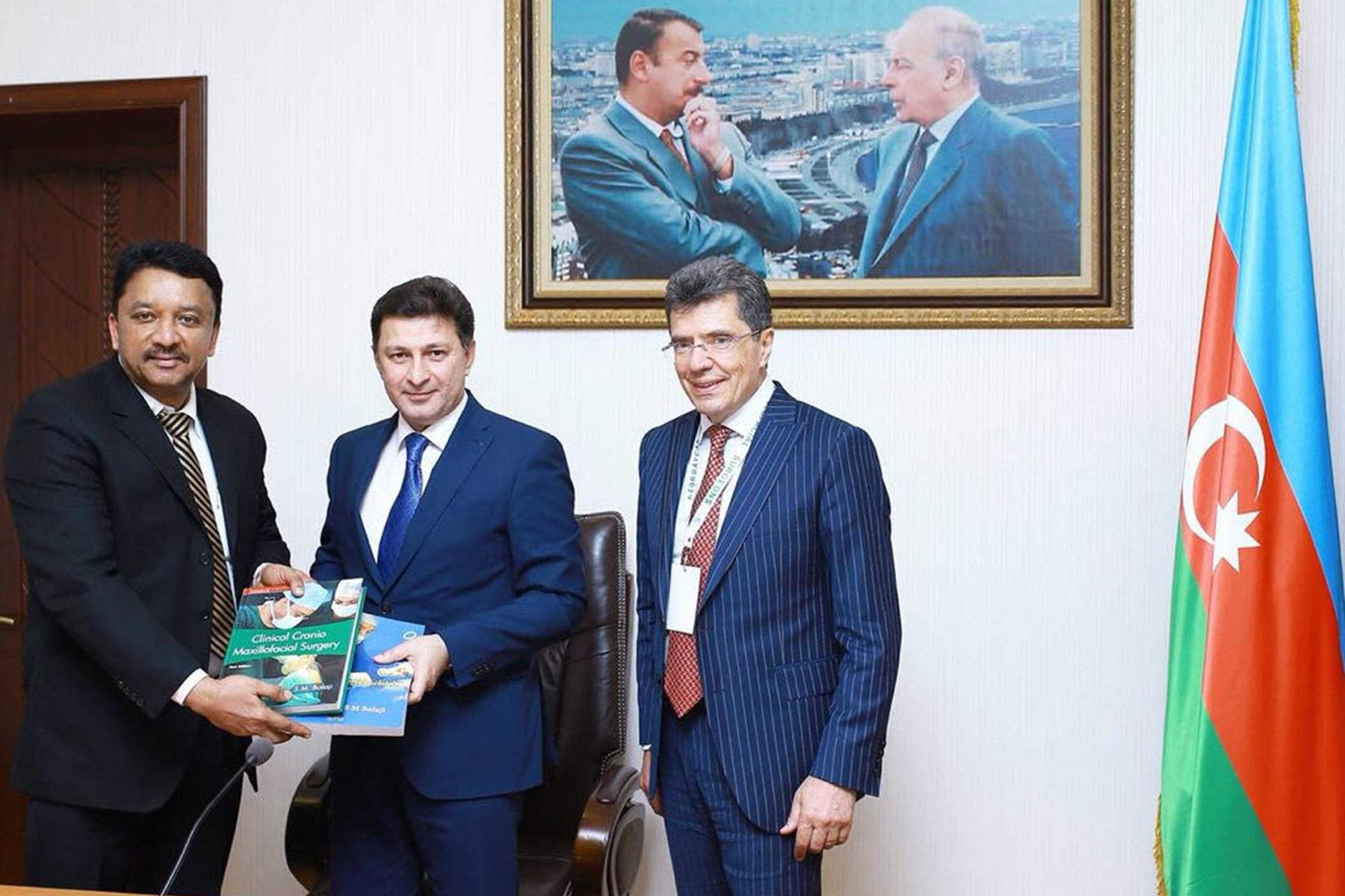 – Dr SM Balaji presenting the Rector, His Excellency Dr Garay Chingiz Garaybayli with a copy of his Clinical Craniomaxillofacial Surgery book