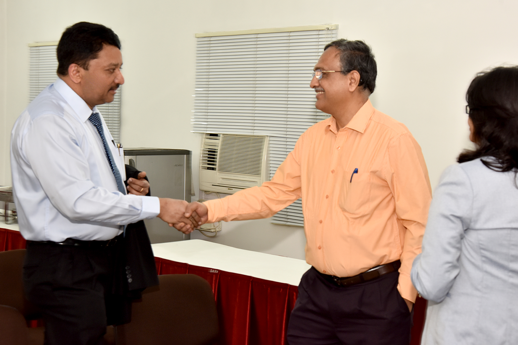 Prof SM Balaji welcomes the head of a city based dental college