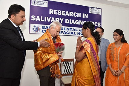 Dr Paul Slowey being honored with a shawl by a distinguished guest
