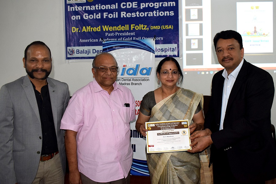Prof Balaji presenting Prof Mahalaxmi with a certificate of appreciation at the completion of her lecture at the CDE program