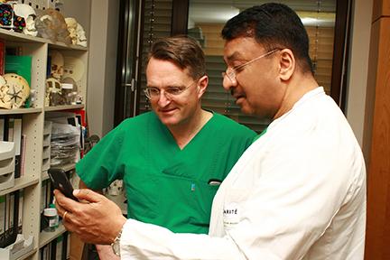 Prof Balaji with Prof Adolphs viewing memorabilia in Prof Adolphs room