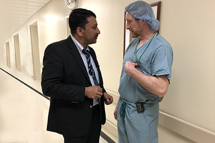 Prof S M Balaji with Dr James Murphy discussing a case scheduled for later in the day-
