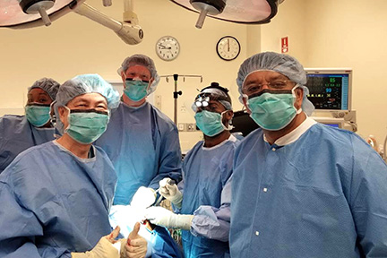 Dr S M Balaji with Dr Fung and Dr Murphy during his visit to the Operating Room as an observer