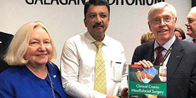 Dr SM Balaji presenting his Clinical Craniomaxillofacial Surgery book to Prof David Johnsen