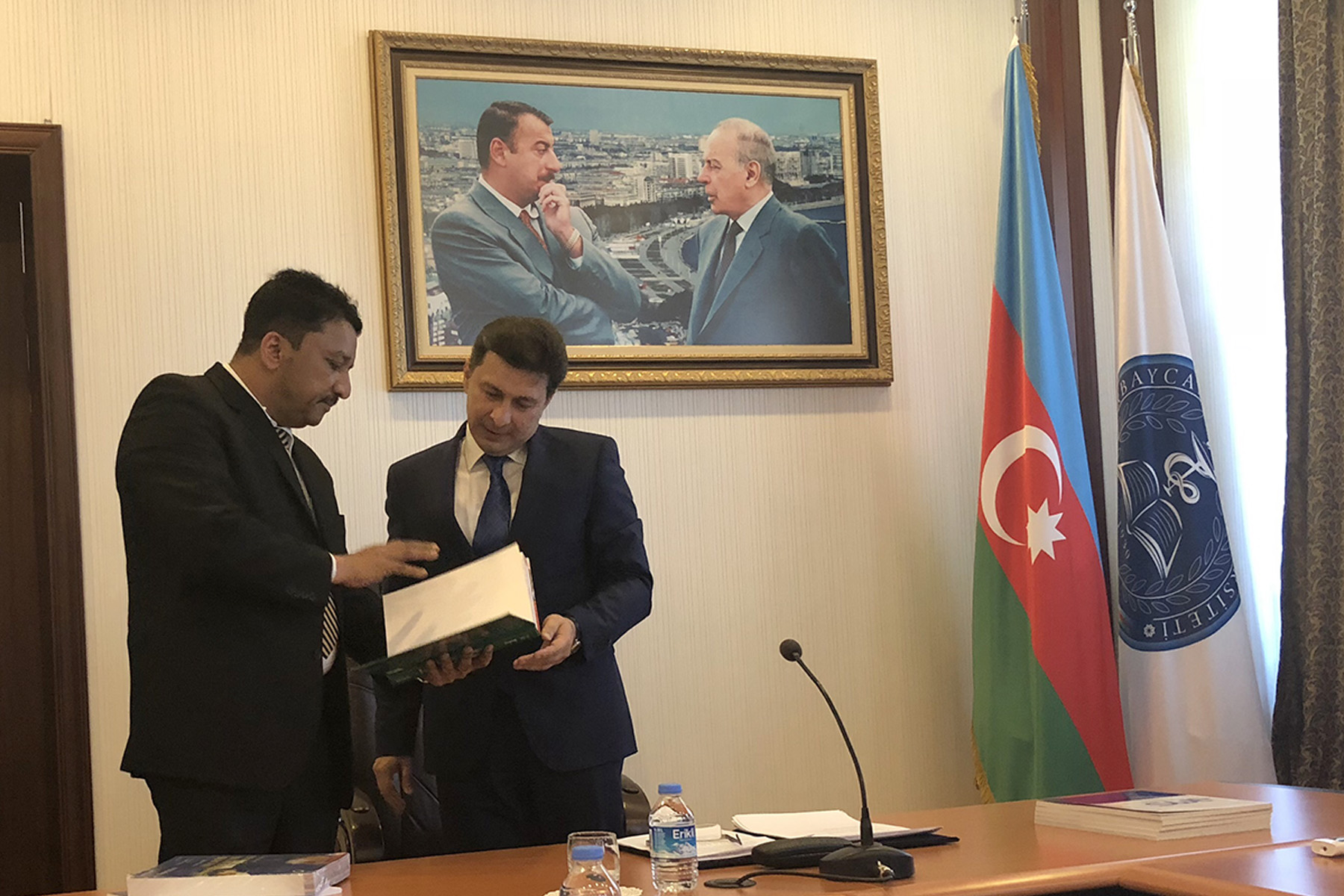 Dr SM Balaji elucidating the salient points of the textbook to the Rector, His Excellency Dr Garay Chingiz Garaybayli