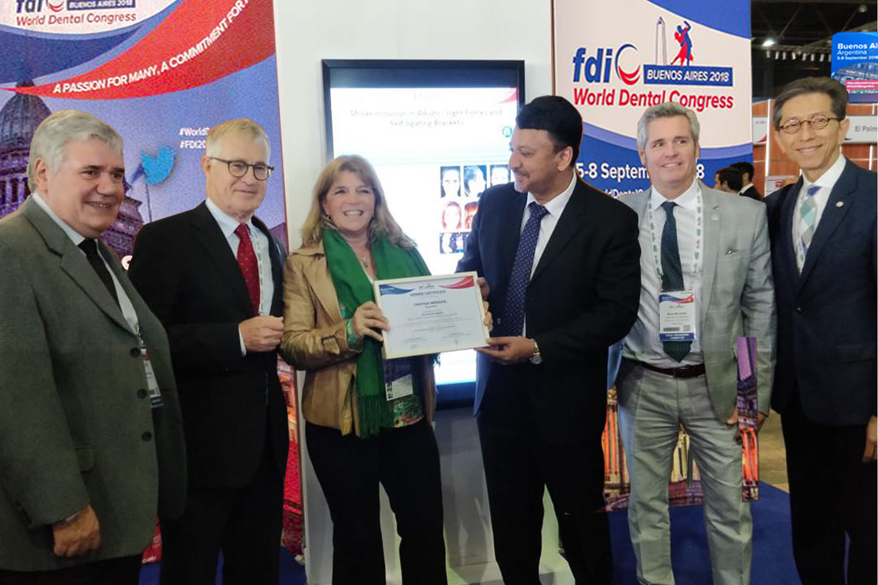 Dr SM Balaji hands a Certificate of Excellence to a winner. Also seen are Dr. Jurgen Fedderwitz, Chair, Education Committee, FDI, Dr. Guillermo Rivero, Congress President, Dr William Cheung, Member, Education Committee and Dr Brian Murdoch, Member, Scientific Committee