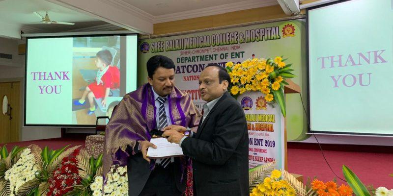 Dr SM Balaji receiving certificate of participation